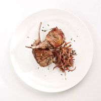 Bacon-Wrapped Lamb Rib Chops Over Caramelized Caraway Onions: Main Image